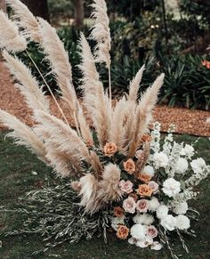 wedding inspo We love this tall, stunning pampas grass! Sitting at the end of the grassy aisle, its the perfect boho addition to any garden wedding. The gorgeous white, orange and blush roses were such a modern trend! Wedding Themes, Wedding Colors, Wedding Styles, Wedding Decorations, Wedding Centerpieces, Wedding Ideas, Wedding Inspiration, Floral Wedding, Wedding Bouquets