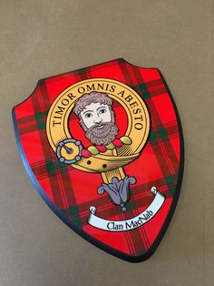 Wooden plaque with printed MacNab crest and tartan