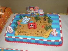 Another easy cake. I could use the chest from her castle and her real jake dolls. Plastic foilage of some sort. I like the map part.