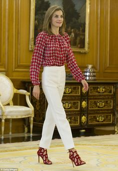 Polished to perfection as ever, Letizia wore her hair straightened and added a subtle slick of pink lipstick and blusher