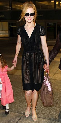NICOLE KIDMAN    Also at LAX, Nicole gets high marks for a perfectly stylish yet comfortable ensemble: a knit black dress and nude kitten heels.