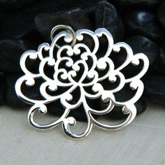 Add a Japanese flair to your jewelry with this Sterling Silver Chrysanthemum Flower Pendant.  Visit http://www.ninadesigns.com/bali_bead_shop/jewelry_search/any/most_relevant/40/1?query=a691 for details.