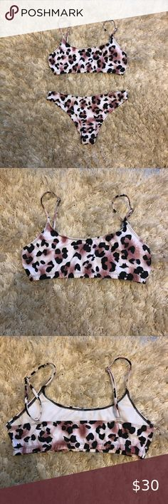 Luna Leopard Bikini Never been worn leopard print bikini. Top is scoop necked and bottoms are slightly cheeky. Selling together or separately if you just want the top or just the bottoms. Leopard Print Bikini, Bikini Colors, Bikini Top, Scoop Neck, Swim, Bikinis, Closet, Things To Sell, Swimming