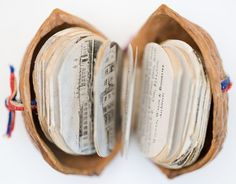 A mini book inside a walnut shell! Glue the first and last of the mini accordioned pages into the two halves of a walnut shell to make it yourself. Geocaching, Altered Books, Altered Art, Diy Tiny Books, Mini Albums, Handmade Books, Book Journal, Journals, Book Binding