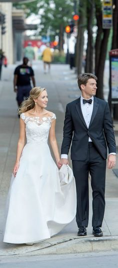 click to see all of our wedding photos! embroidered lace off the shoulder boatneck fit and flare wedding gown/dress a-line trumpet style // oscar de la renta // armani classic groom's tuxedo // armani // downtown milwaukee city wedding photography