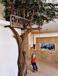 Indoor tree house with swing. You'd have to have a space big enough to do it, but O.M.G. Do want.