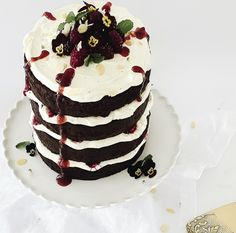 Chocolate Mud Cake, is super decadent, moist and fudgy. With a dark rich flavour of chocolate and a hint of coffee, to me it's like a chocolate brownies' luxurious older brother. This Layered Chocolate Mud Cake is an absolute showstopper. I've sandwiched the delicious layers together with whipped cream frosting and fresh blackberries.