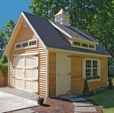 I love how this Kloter Farms Elite Cape shed looks with the cedar siding, and the painted windows and doors.