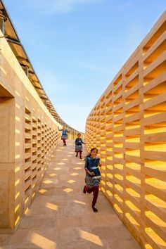 Diana Kellogg Architects oriented the building to maximise the breeze from the wind and make it work with the school's elliptical form to passively cool the building. Diana, All Girls School, Concrete Facade, India School, Rural India, Blue Mosaic, Canopy Cover, Exhibition Space, Dezeen