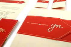"""Genia Narinskaya   Personal Identity   I believe that a designer's personal brand can be a powerful introduction to both his or her work and personality. My print identity is meant to be both very clear and simple and also grab the recepient's attention. A simple """"banner"""" bar incorporates my name and hand-generated initials. The business card is a fold and has a perforated strip that holds it together. This ads something surprising and fun.   Image 2 of 5"""