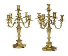 A pair of French late 19th century Louis XIV style gilt-bronze seven-light candelabra by Henry Dasson, dated 1887, Paris (2). AUCTION 22615: PERIOD DESIGN 17 Feb 2015 12:30 GMT  LONDON, KNIGHTSBRIDGE