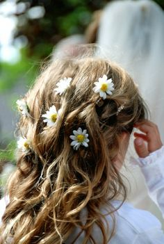 Like the curly hair w/stuff in the hair, not flowers. Maybe little diamonds