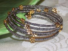 Golden Daisy Wrap Bracelet by EriniJewel on Etsy, $12.00