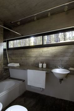 Use concrete in your bathroom if you prefer an industrial-looking design