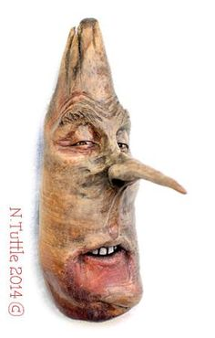 """You Bore Me""     5 inches tall and 1¾ inches wide and   4¼ inches to the tip of his pointy nose.  I've added just a touch of white oil paint  to his eyes and teeth to make them pop!  Signed and dated:   N. Tuttle 12/17/14"