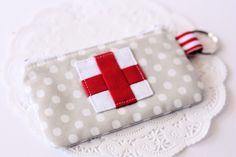 How cute is this tutorial: Emergency Zippered Pouch | A Spoonful of Sugar. This would look awesome with an applique too!