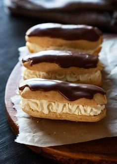 This Classic Eclair recipe is a Pate a Choux based hollow pastry shell filled with creamy custard, then dipped into a shiny chocolate glaze. Simple, yet sophisticated and all around delicious Chocolate Eclair Recipe! Creative Desserts, Just Desserts, Delicious Desserts, Dessert Recipes, Yummy Food, French Desserts, Choux Pastry, Shortcrust Pastry, Pastry Recipes