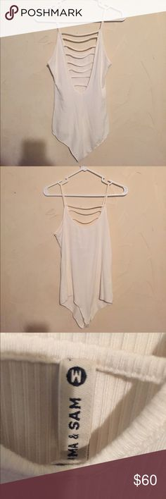 NWOT LF Emma & Sam Ladder Bodysuit NWOT LF Emma & Sam Ladder Bodysuit. Size Medium. Priced Higher because I am looking for this in black!!Looking to trade for a Black one in the same size. I know the black bodysuits like this are hard to find but I really need one. If you happen to have one please let me on I can buy it from you if you are not wanting to trade. LF Tops Tank Tops