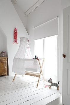 Simply white baby's room