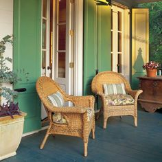 Jazz Up Your Patio Doors | The louvered look isn't for everyone. These solid-panel shutters offer extra protection for two pairs of patio doors. The shutters fold back flush against the wall when opened. | SouthernLiving.com