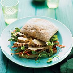 Grilled Chicken and Pea Shoot Charmoula Sandwiches | Before grilling, marinate chicken tenders in a paste made with cilantro, garlic, olive oil and lemon juice then serve on ciabatta bread topped with garden fresh carrot and tender pea shoots.