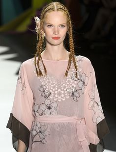BRAIDS: At Desigual, the models hit the catwalk in braided styles that paired well with the psychedelic looks. This is one spring 2016 trend that is easy to copy. Try a few braids to bring some playfulness to your look or braid your own hair for a tropical style.