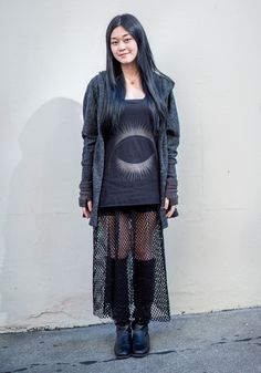 """Leyla, 19""""I'm wearing a black vest, an oversized jersey coat, and a long net skirt with a mini skirt inside. I love black and clothes that look sexy and cool. I like trying and matching different styles together. But basically I just wear what looks great that moment.""""Mar 6, 2015 ∙ Civic Center"""