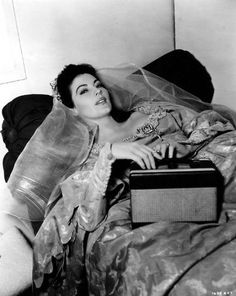 Ava Gardner listening to the radio on the set of Knights of the Round Table, 1953.
