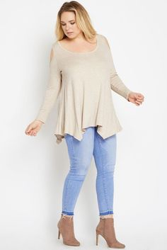 The cold shoulder trend is a year long favorite as will be this top! Ribbed knit makes for comfortable wear and stretchy, fitted long sleeves create warmth. Complete with a handkerchief hem for a flowy silhouette. Wear it with jeans or dress it up with leather leggings and heels