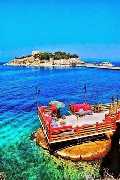 Explore the beach resort town of Kusadasi, Turkey. Restaurants line the seafront promenade that sits on the Aegean Sea.