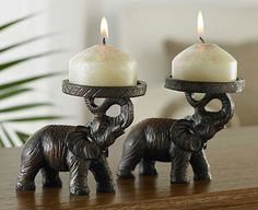 Original Gift Company Elephant Candle Holders, Pair, Resin With their trunks held upwards, proffering a candle, these stately elephants are a symbol of good luck in Western culture. Looking majestic either end of a mantelpiece or dining table, they are an ori http://www.MightGet.com/february-2017-2/original-gift-company-elephant-candle-holders-pair-resin.asp