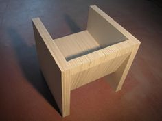Chair made of grey cardboard by Reinier de Jong.