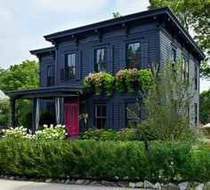 Roger Hazard and Chris Stout-Hazard's Black House with Pink Door in New York sherwin williams 'inkwell' in varying finishes