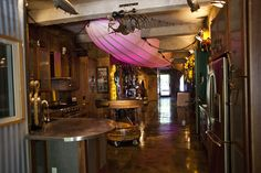 Steampunk Loft in Manhattan. Who doesen't want a glowing dirigible as a lighting element in their kitchen?