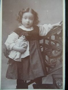 A CHARMING CDV - A LITTLE GIRL HOLDING A DOLL, EMBERSON & SONS