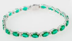 Bracelets : Oval lab-created emerald and diamond bracelet in 18k white gold
