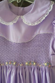 Made by Linda Regan Creamer. Dress pattern used both B's Classic yoke and Australian Smocking Winter Garden also for plate. Issue #59 A. S. Fabric is imperial broadcloth.