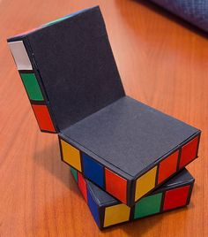 rubik's cube moving card constructed of three stacked boxes... movement created with a hinge between top and middle and a brad between middle and bottom to enable spinning.