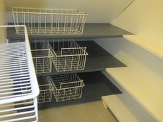 narrow shelves under stairs | Bluegrass Mom's Perspective : Bookshelves and a Pantry..
