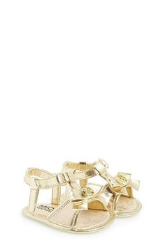 Free shipping and returns on MICHAEL Michael Kors 'Joy Kya' Crib Shoe (Baby) at Nordstrom.com. A polished logo medallion highlights the dainty bow of a playful T-strap sandal set on a flexible crib-shoe sole.