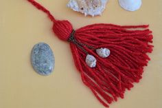 Gorgeous bright red handmade tassel with two shells attached to a chain, perfect for the fall and holiday season to decorate your planner,
