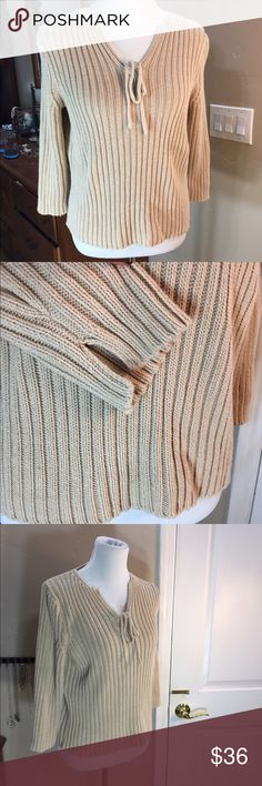 "J. Crew Sweater J. Crew Sweater. Size Medium. Tan sweater with front tie. Thick ribbing and notched 3/4 sleeves. Detailed twist Knit up back of sleeves. Simple and classic.  Flat measurements: length 21"", sleeves 17.5"" and chest approx 19"". Cotton. No stains or pilling. Excellent used condition. J. Crew Sweaters V-Necks"
