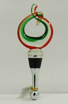 "Ganz Red Green Glass Wine Bottle Stopper Cork Circular Gift NEW! by Ganz. $15.99. Ganz  Bella Casa Bottle Stopper  This beautiful red and green wine bottle stopper is made with glass. The top is circular and the base is silver with a large rubber seal.  This stopper is 5.25"" tall.   Item # BC15318-5  This item is brand new and comes in a foam lined gift box.    International Buyers Welcome."