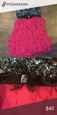 A Jodi Kristopher strapless sequin party dress Strapless sequin top with pink ruffle bottom. Zip closure, attached appliqué belt. Worn once, no defects Jodi Kristopher Dresses Strapless