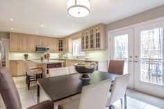 Humber Valley Family Home Kitchen with Walk-Out to Deck Valley Village, Walk Out, Storage Spaces, Home Kitchens, Home And Family, Deck, Table, Room