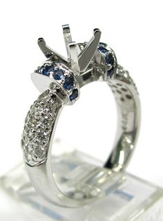 Ladies 14kt white gold semi mount. Mounted in ring are 26 brilliant round cut diamonds weighing a total of .48ct and 14 brilliant round cut blue sapphires weighing a total of .31ct. The head can be changed to take any size and shape diamond in the center.