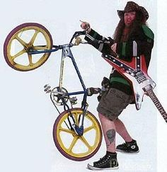 Dimebag Darrell, guitar and bike in hand. Still more metal than you.