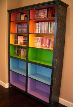 Colored Bookshelves. I love this. Just cheap pine book cases,dark wood stain and rainbow paints : )