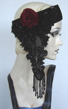 Flapper Black Beaded Headdress With Red Fabric Flower.    via Etsy.