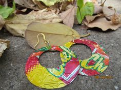 soda can transformed into a work of art  earrings are by Soda2Art